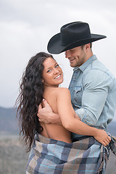 cowboy with a girl in a blanket outdoors