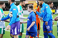 Mascots shaking hands  before the EFL Sky Bet League 1 match between AFC Wimbledon and Plymouth Argyle at the Cherry Red Records Stadium, Kingston, England on 26 December 2018.