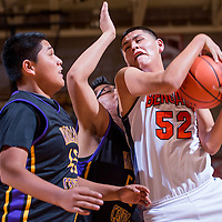 121913       Cable Hoover<br /> <br /> Gallup Bengal Joe Yazzie (52) wrestles a rebound away from the Kirtland Central Broncos Thursday at Gallup High School.
