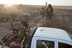 20/10/2016. Bashiqa, Iraq. Kurdish peshmerga fighters advance at the beginning of a large offensive to retake the Bashiqa area from Islamic State militants today (20/10/2016).<br /> <br /> Launched in the early hours of today with support from coalition special forces and air strikes, the attack is part of the larger operation to retake Mosul from the Islamic State, and involves both the Kurds and the Iraqi Army. The city of Bashiqa, around 9 miles north of Mosul, is one of several gateway areas that must be taken before any attempted offensive on Mosul itself.<br /> <br /> Despite the peshmerga suffering several casualties after militants fought back using mortars, heavy machine guns and snipers, the Kurdish forces were quickly taking ground with Haider al-Abadi, the Iraqi prime minister, stating that the operation to retake Mosul was progressing faster than expected. Photo credit: Matt Cetti-Roberts/LNP