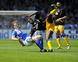 Bristol Rovers' Seanan Clucas battles for the ball with Mansfields Anthony Howell- Photo mandatory by-line: Joe Meredith/JMP - Mobile: 07966 386802 03/05/2014 - SPORT - FOOTBALL - Bristol - Memorial Stadium - Bristol Rovers v Mansfield - Sky Bet League Two