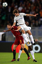 Roma's Edin Dzeko and Chelsea's Pedro battle for the ball