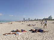Sunbathers lying on beach Miami USA