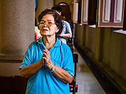 27 MARCH 2016 - BANGKOK, THAILAND:  A woman prays during Easter services at Santa Cruz Church in Bangkok. Santa Cruz was one of the first Catholic churches established in Bangkok. It was built in the late 1700s by Portuguese soldiers allied with King Taksin the Great in his battles against the Burmese who invaded Thailand (then Siam). There are about 300,000 Catholics in Thailand, in 10 dioceses with 436 parishes. Easter marks the resurrection of Jesus after his crucifixion and is celebrated in Christian communities around the world.     PHOTO BY JACK KURTZ