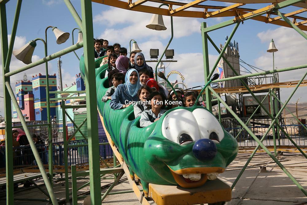 Children at an amusement park in Amman, Jordan