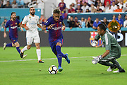 Barcelona Neymar takes on Real Madrid Goalkeeper Keylor Navas during the International Champions Cup match between Real Madrid and FC Barcelona at the Hard Rock Stadium, Miami on 29 July 2017.