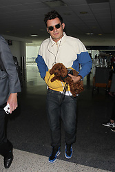 Orlando Bloom arrives into LAX with his dog in under his arm.<br /><br />16 June 2017.<br /><br />Please byline: Vantagenews.com