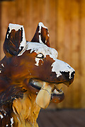Decaying plaster dog on porch in Pioneer Town, CA