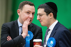 © Licensed to London News Pictures . 13/12/2019. Bury, UK. Two supporters of the Conservative Party at the count for seats in the constituencies of Bury North and Bury South in the 2019 UK General Election , at Castle Leisure Centre in Bury . Photo credit: Joel Goodman/LNP