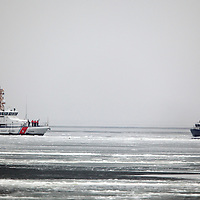 The US Coast Guard  87' Coastal Patrol Boat Sailfish based out of Coast Guard Station Sandy Hook doing maneuvers in Sandy Hook Bay severely iced over during the winter.  Alonside the Sailfish at right is the motor life boat 47209