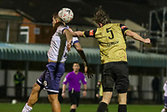 Marine defender Anthony Miley (5) heads towards the goal during the The FA Cup match between Marine and Havant & Waterlooville FC at Marine Travel Arena, Great Crosby, United Kingdom on 29 November 2020.