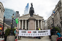 London, UK. 27th August, 2021. Environmental activists from Extinction Rebellion assemble outside the Bank of England for a Blood Money March through the City of London. Extinction Rebellion were intending to highlight financial institutions funding fossil fuel projects, especially in the Global South, as well as law firms and institutions which facilitate them, whilst calling on the UK government to cease all new fossil fuel investment with immediate effect.