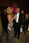Claire Johnson and John Caudwell, The British Fashion Awards  2006 sponsored by Swarovski . Victoria and Albert Museum. 2 November 2006. ONE TIME USE ONLY - DO NOT ARCHIVE  © Copyright Photograph by Dafydd Jones 66 Stockwell Park Rd. London SW9 0DA Tel 020 7733 0108 www.dafjones.com