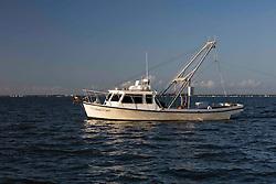 Side view of Texas Parks & Wildlife Coastal Fisheries trawling boat in Galveston Bay on Texas Gulf Coast.