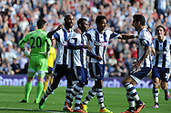 West Brom's Stephane Sessegnon © celebrates with teammates after he scores the 1st goal. Barclays Premier league match, West Bromwich Albion v Sunderland at the Hawthorns in West Bromwich, England on Sat 21st Sept 2013. pic by Andrew Orchard, Andrew Orchard sports photography,