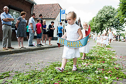 June 18, 2017 - Boxmeer, Netherland - People take part a the ''Boxmeerse Vaart'' - an ancient Holy Blood procession that originated in the year 1400 in Boxmeer, Netherlands, on 18 June 2017.. Thousands of people attended the Procession, which has been held every year on second Sunday after Whitsun. The tradition recovers that a priest doubted to the conversion of bread and wine into the body and blood of Christ. Blood sparkled over the cup and a drop of blood remained on the corporale (white linen) behind after the priest its error recognized. This white linen has been kept in the old silver reliquary remained and put away and becomes shown in the Boxmeer-Procession. (Credit Image: © Romy Arroyo Fernandez/NurPhoto via ZUMA Press)