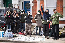 © Licensed to London News Pictures. 29/03/2021. London, UK. Evicted squatters gather near the former Cavendish Road Police Station in Clapham in south London where they occupied the building as part of a 'Kill The Bill' protest. Murdered woman Sarah Everard walked past the building on the night she went missing on March 3, 2021. Photo credit: Ben Cawthra/LNP