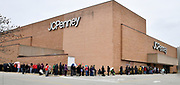 Shoppers wait in a line that wrapped around the JC Penney's store at the St. Clair Square mall, which opened at 2 pm. Shoppers looking for bargains and discounted items endured a light but steady rain on Thanksgiving Day as they waited for stores to open in Fairview Heights, IL on November 28, 2019.<br />  Photo by Tim Vizer