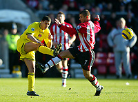 Fotball<br /> Premier League England 2004/2005<br /> Foto: BPI/Digitalsport<br /> NORWAY ONLY<br /> <br /> Southampton v Charlton Athletic<br /> <br /> 26/12/2004<br /> <br /> Talal El Karkouri of Charlton clears from Kevin Phillips