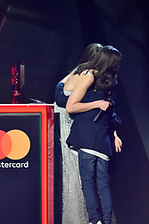 EDITORIAL USE ONLY.<br /><br /> Dua Lipa, with her brother and sister, accepting the award for British Breakthrough on stage at the Brit Awards at the O2 Arena, London.
