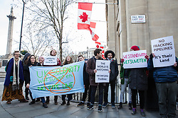 London, UK. 9th January, 2019. Environmental campaigners protest outside the Canadian High Commission in solidarity with the Wet'suwet'en, a First Nations people from British Columbia who are currently facing forced eviction after having blocked the construction by TransCanada of a fracked gas pipeline across their territories.