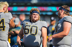 Sep 11, 2021; Morgantown, West Virginia, USA; West Virginia Mountaineers offensive lineman Noah Drummond (60) smiles during warmups prior to their game against the Long Island Sharks at Mountaineer Field at Milan Puskar Stadium. Mandatory Credit: Ben Queen-USA TODAY Sports