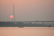 Sunset over the river Ganges at the sacred Triveni Sangam, the confluence of the rivers Ganges and Jamuna and the mythical Sarasvarti river at Allahabad, Uttar Pradesh, India
