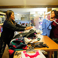 111913  Adron Gardner/Independent<br /> <br /> Shi'ma Transport  Marketing Director Cindy Nelson, left, <br /> and Sh'ma Transport volunteer Ursula Johnson select clothing for the Eastern Navajo Child Drive in Bluewater Tuesday.