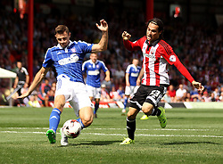 Brentford's Jota is tackled by Ipswich Town's Tommy Smith - Mandatory by-line: Robbie Stephenson/JMP - 07966386802 - 08/08/2015 - SPORT - FOOTBALL - Brentford,England - Griffin Park - Brentford v Ipswich Town - Sky-Bet Championship