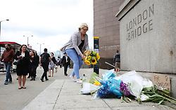 People lay flowers near London Bridge following Saturday's terrorist attack.