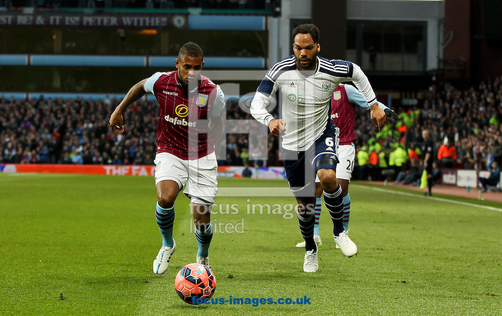 Leandro Bacuna (left) of Aston Villa and Joleon Lescott (right) of West Bromwich Albion race to the ball during the FA Cup match at Villa Park, Birmingham<br /> Picture by Tom Smith/Focus Images Ltd 07545141164<br /> 07/03/2015