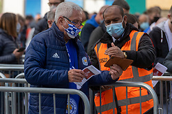 © Licensed to London News Pictures. 15/05/2021. London, UK. A Chelsea football fan shows his Covid test result at Wembley Stadium attending the Emirates FA Cup Final between Chelsea football club and Leicester City football club. All attendees have to show evidence of a negative Covid-19 test to attend the event as part of the Events Research Programme (ERP) pilot scheme informing the government's decision on step 4 of its roadmap out of lockdown. Photo credit: Ray Tang/LNP