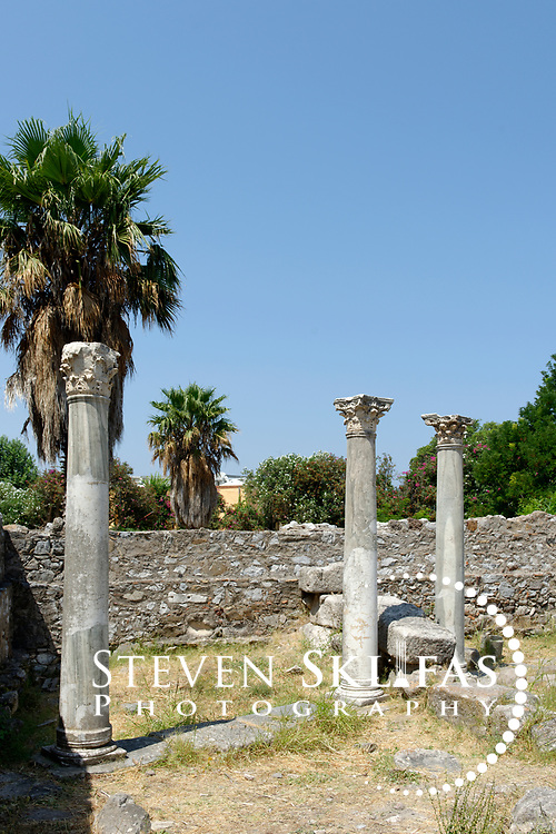 Kos Town.  View of the harbour stoa upright columns in the harbour quarter of the ancient city. Kos is part of the Dodecanese island group and birthplace of the ancient physician and father of medicine, Hippocrates.