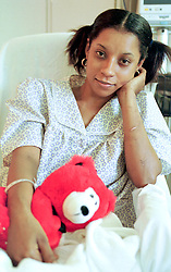23 September 2001. Bellevue Hospital, New York City, New York, USA.<br /> Genelle Guzman-McMillan - nee Genelle Guzman. Aftermath of 9/11 Terrorist attack on World Trade Centre.<br /> Last known survivor.<br /> Genelle Guzman sits up in bed in Bellevue hospital as she recovers from being trapped in the rubble of the World Trade Center debris. Genelle was trapped for 27 hours, pinned by heavy debris after the buildings collapsed around her killing her work colleagues. By some miracle Genelle attributes to God she was spared. Genelle was found by a German Shepherd rescue dog named Trakr and his handler James Symington.<br /> Genelle was told she would never recover from the crushing injuries to her legs, however she has since overcome the odds and went on to marry her sweetheart Roger McMillan who cared for in hospital throughout her ordeal.  <br /> Photo©; Charlie Varley/varleypix.com