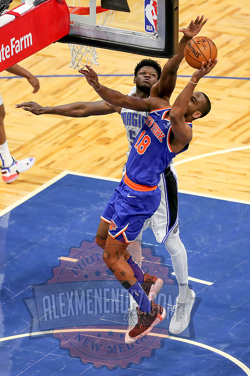ORLANDO, FL - FEBRUARY 17:  Mo Bamba #5 of the Orlando Magic blocks a shot attempt by Alec Burks #18 of the New York Knicks during the second half at Amway Center on February 17, 2021 in Orlando, Florida. NOTE TO USER: User expressly acknowledges and agrees that, by downloading and or using this photograph, User is consenting to the terms and conditions of the Getty Images License Agreement. (Photo by Alex Menendez/Getty Images)*** Local Caption *** Mo Bamba; Alec Burks