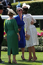 Zara Tindall (centre) greets Kate, the Duchess of Cambridge (right), during day one of Royal Ascot at Ascot Racecourse.