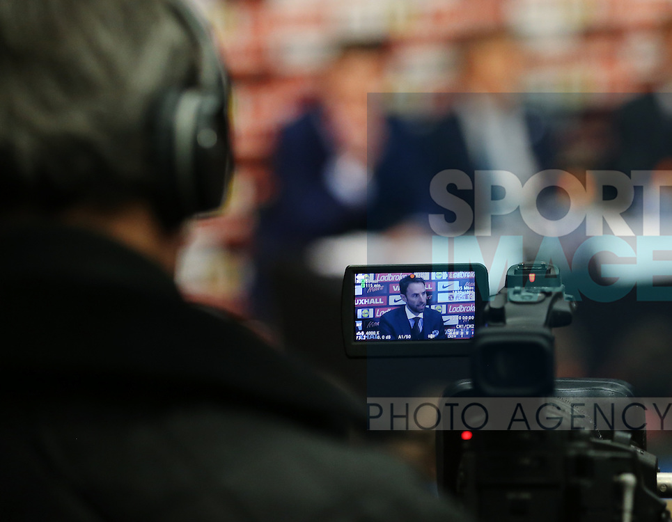 A cameraman films England's Gareth Southgate  during his press conference at Wembley Stadium, London. Picture date December 1st, 2016 Pic David Klein/Sportimage