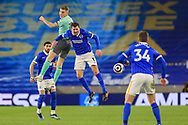 Everton defender Seamus Coleman (23) battles with Brighton and Hove Albion midfielder Pascal Gross (13) for a header during the Premier League match between Brighton and Hove Albion and Everton at the American Express Community Stadium, Brighton and Hove, England UK on 12 April 2021.