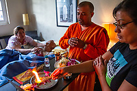 Union City, California | 2014<br /> Yojna Verma performs last rites with the Hindu priest and the hospice nurse for her father Shyam, who was suffering from gall bladder cancer. A popular guide in Delhi for international clients in the 1970s and '80s, Shyam emigrated to New York in 1986 and became a fine jewelry salesman at Bloomingdale's department store. He was Bloomingdale's top-grossing salesman for many years before he retired and moved to California. He died at age 78.
