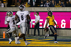California wide receiver Nikko Remigio (4) carries the ball into the end zone ahead of two Nevada defenders on a two-yard touchdown pass during the first quarter of an NCAA college football game, Saturday, Sept. 4, 2021, in Berkeley, Calif. (AP Photo/D. Ross Cameron)