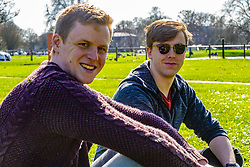 Charlie Sheil, 23 from Dublin and Will Hamilton, 23, right, gives their views on Brexit on Clapham Common in South London. London, March 24 2019.