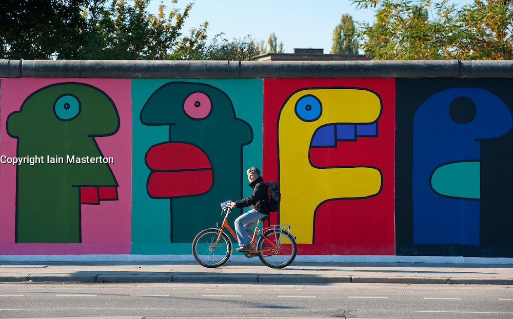 Colourful newly repainted murals on Berlin Wall at the East Side Gallery in Kreuzberg Berlin