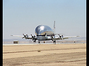 The jumbo JUMBO jet: Nasa's super-sized plane can carry 26 tonnes of spaceship parts and still travel at 290mph<br /> <br /> It might look like a giant whale in the sky, but this super-size plane is in fact Nasa's answer to shipping spacecraft components around the world.<br /> Dubbed the Super Guppy, the aircraft is able to swallow other planes whole and has played a vital role in missions including Gemini and Skylab.<br /> The Aero Spacelines Super Guppy was first created in 1962 as a successor to the aptly-named Pregnant Guppy cargo aircraft.<br /> <br /> <br /> Pregnant Guppy helped achieve President Kennedy's goal of getting to the moon by the end of the 1960s.<br /> Without Pregnant Guppy, the only other way to get the Apollo rocket stages from California to Florida was on a slow boat through the Panama Canal.<br /> <br /> <br /> The Pregnant Guppy was so successful that ASI built a second larger Guppy for larger, heavier loads.<br /> There have been five Super Guppies built today, helping move spacecraft parts and fuel to vital locations,<br /> <br /> <br /> Nasa describes the craft, which looks like it shouldn't be able to fly, as 'an innovative composite rocket fuel tank.'<br /> Equipment and fuel is loaded and unloaded via a hinged nose at the front of the huge plane.<br /> The original Super Guppy measured 141 ft (43m) long by 25 ft wide (8m) and could carry 54,000lbs (24500kg) of cargo at a cruising speed of 300 mph.<br /> The later Super Guppy Turbine has a 156 ft (48m) wingspan, is143 ft (44m) long and 37 ft (11m) tall. It can carry a payload over 52,500 lbs (24,000kg)at 290 mph up to 564 miles.<br /> The most important difference between it and its predecessor was an upgrade to more reliable and readily available Allison T-56 turboprops.<br /> Airbus Industries commissioned and operated four SGT Super Guppy Transport aircraft to ferry large A300 fuselage sections throughout Europe during the last three decades of the 20th century.<br /> When Airbus re