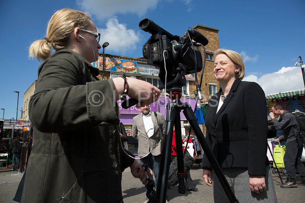 London, UK. Thursday 30th April 2015. Leader of the Green Party, Natalie Bennett being interviewed for tv as she pays a visit to talk to local people and stall holders at Ridley Road Market in Dalston, Borough of Hackney, at the heart of multicultural East London. Natalie Bennett is an Australian-born British politician and journalist. She was elected to her position as the leader of the Green Party of England and Wales in 2012.