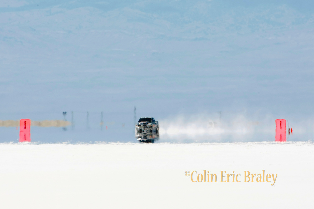 2009 Bonneville Speed Week- Heat waves off the salt create a mirage effect as the Jesel Land Speed Team's 2005 Blown Modified, Dodge Ram Pickup, driven by Wayne Jesel of Mooresville, North Carolina, makes a run at the Bonneville Speed Way. August 9, 2009.  Photo by Colin E. Braley