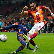 Galatasaray's Yasin Oztekin (R) and Istanbul Basaksehir's Stephane Badji (L) during their Turkish Super League soccer match Galatasaray between Istanbul Basaksehir at the AliSamiYen Spor Kompleksi TT Arena at Seyrantepe in Istanbul Turkey on Saturday, 14 March 2015. Photo by Aykut AKICI/TURKPIX