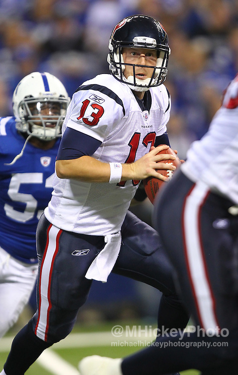 Dec. 22, 2011; Indianapolis, IN, USA; Houston Texans quarterback T.J. Yates (13) looks to pass off the ball against the Indianapolis Colts at Lucas Oil Stadium. Mandatory credit: Michael Hickey-US PRESSWIRE