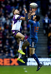 Scotland's Tommy Seymour (left) and France's Geoffrey Palis (right) battle for the ball during the NatWest 6 Nations match at BT Murrayfield, Edinburgh.