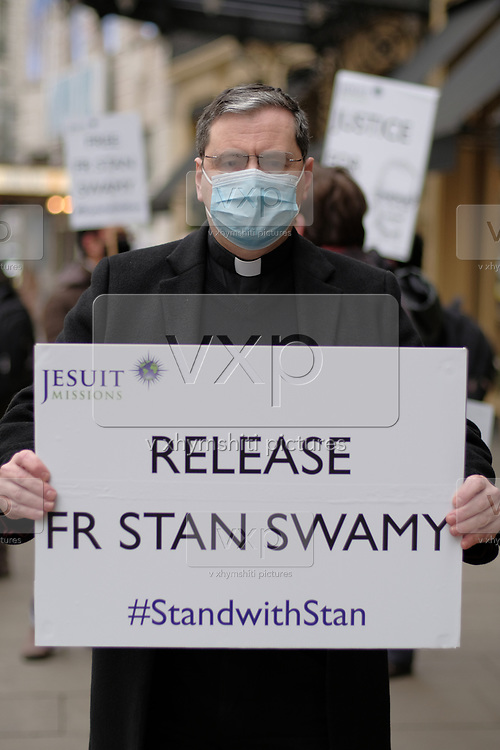 """A priest from """"Jesuit Mission"""" hold placards outside Indian High Comission in London to protest against arrest of Father Stan Swamy on Thursday, Dec 10, 2020. <br /> The National Investigation Agency (NIA), which deals with anti-terror crimes, arrested him in connection over a 2018 incident of caste-based violence and alleged links with Maoists. The 83-year-old activist and Jesuit priest is now the oldest person to be accused of terrorism in India. (VXP Photo/ Gio Strondl)"""