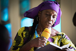 31 October 2019, Monrovia, Liberia: Pauline Roberts reads the Bible as the Lutheran World Federation launches an SDG mapping for Liberia in Saint Peter Lutheran Church. The event takes place during the annual global meeting of the Waking the Giant initiative of the Lutheran World Federation.